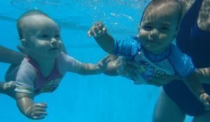 Babies swim and learn diving